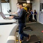 Employees work at treadmill desks in the new Google Chicago Headquarters Thursday, Dec. 3, 2015, in Chicago. The new offices occupy about 200,000 square feet and house a staff of around 650 full time employees. (AP Photo/M. Spencer Green)